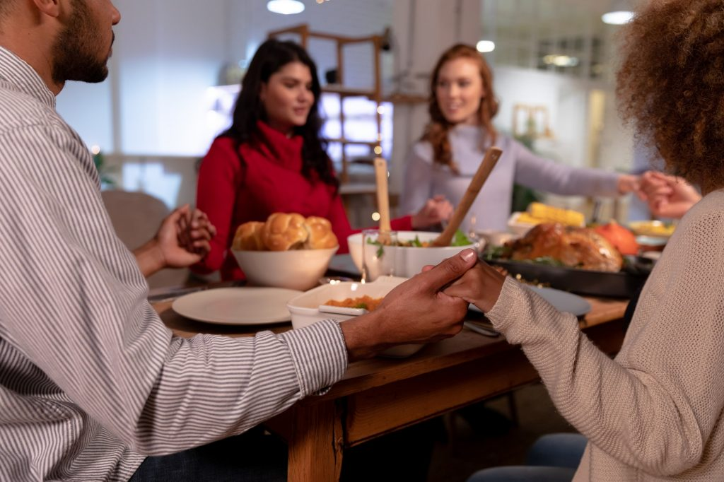 Millennial adult friends celebrating Thanksgiving together at home